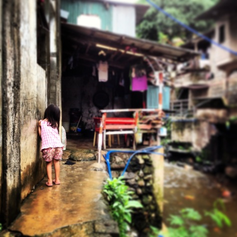 Child along pathway in Rowenas Barangay.