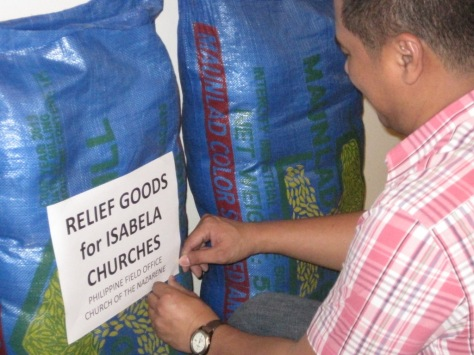 Preparing bags of rice for disaster response.