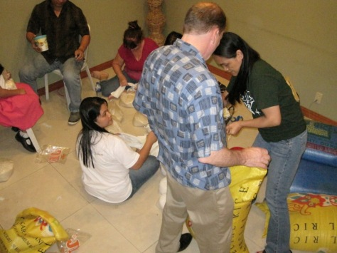 Packing relief supplies with field office staff and work and witness team members.