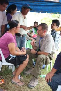 Todd triaging patients at a mobile medical clinic in the Philippines.