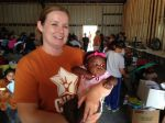Jenny loves on one of the children at the Cactus Nazarene Ministry Center.