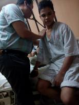 Roldan's Thoracic Surgeon, Dr. Rhonnie Cacas, checking his heart before surgery.