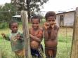 Children awaiting the plane at Dusin.